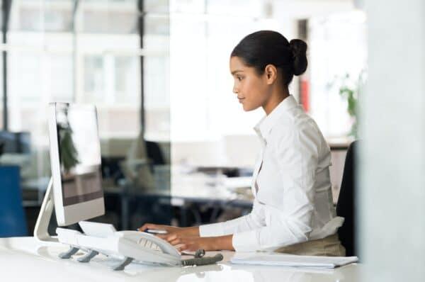 Secretary at computer desk